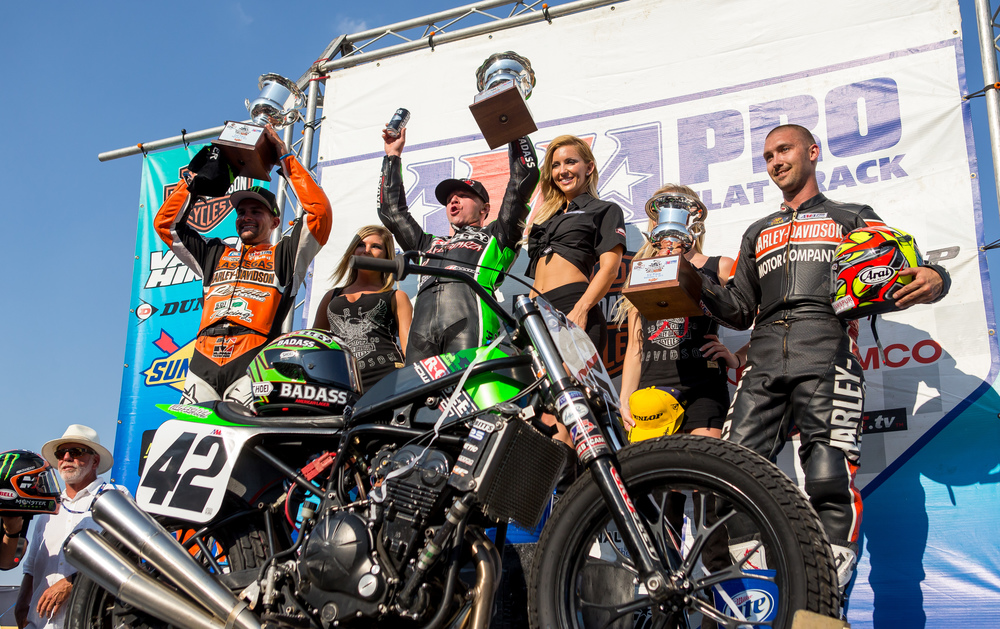 Bryan Smith, center, celebrates his sixth win on the podium after taking the checkered flag over Jared Mees, left, and Jake Johnson, right, in the AMA Pro Flat Track Grand National Championship Springfield Mile II at the Illinois State Fairgrounds, Sunday, Sept. 6, 2015, in Springfield, Ill. Justin L. Fowler/The State Journal-Register