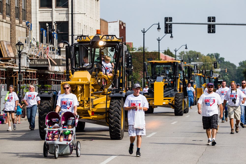 Heavy machinery rolls down Fifth Street with Operating Engineers Local #965 during the annual Labor Day Parade, Monday, Sept. 7, 2015, in Springfield, Ill. Justin L. Fowler/The State Journal-Register