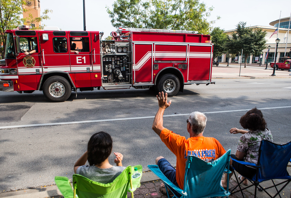 An engine with the Springfield Fire Department helps the parade step off on Jefferson Street during the annual Labor Day Parade, Monday, Sept. 7, 2015, in Springfield, Ill. Justin L. Fowler/The State Journal-Register