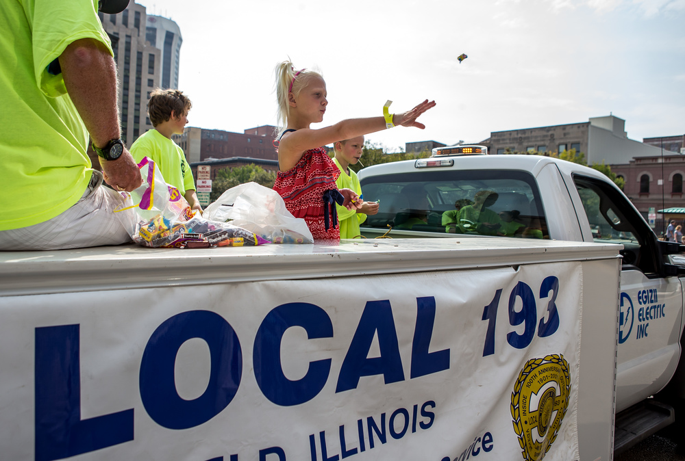 Brooklyn Sturgis, 5, throws out candy for IBEW Local #193 during the annual Labor Day Parade, Monday, Sept. 7, 2015, in Springfield, Ill. Justin L. Fowler/The State Journal-Register