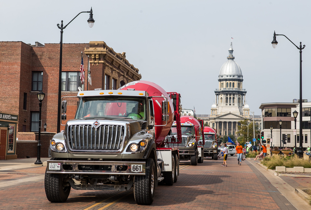 Cement trucks make their way down Capitol Avenue with Laborers Local #477 during the annual Labor Day Parade, Monday, Sept. 7, 2015, in Springfield, Ill. Justin L. Fowler/The State Journal-Register