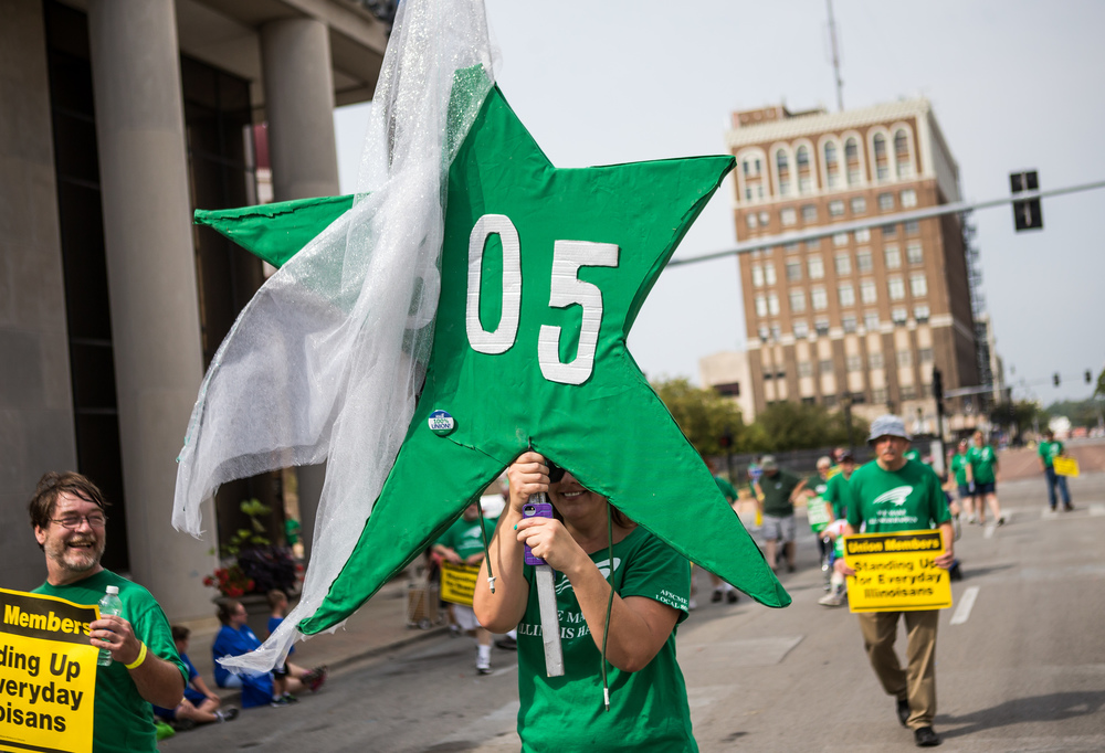 Kristen Nolan marches with AFSCME #805 during the annual Labor Day Parade, Monday, Sept. 7, 2015, in Springfield, Ill. Justin L. Fowler/The State Journal-Register