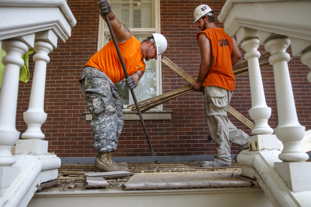 Mark Ryan, left, and Zach Lyon remove wood from the lower balcony on the west side of the Executive Mansion Tuesday, Sept. 1, 2015. The work is part of more than $8.5 million in needed repairs identified in a recent Capital Development Board analysis of the property including roof leaks, water damage to walls and ceilings, exterior wood decay, window leaks, peeling paint, crumbled pavement, buckled veranda decks, outdated heating and cooling systems, fire safety improvements and more. The mansion is the official residence of each sitting governor and was last restored in 1971. Ted Schurter/The State Journal-Register
