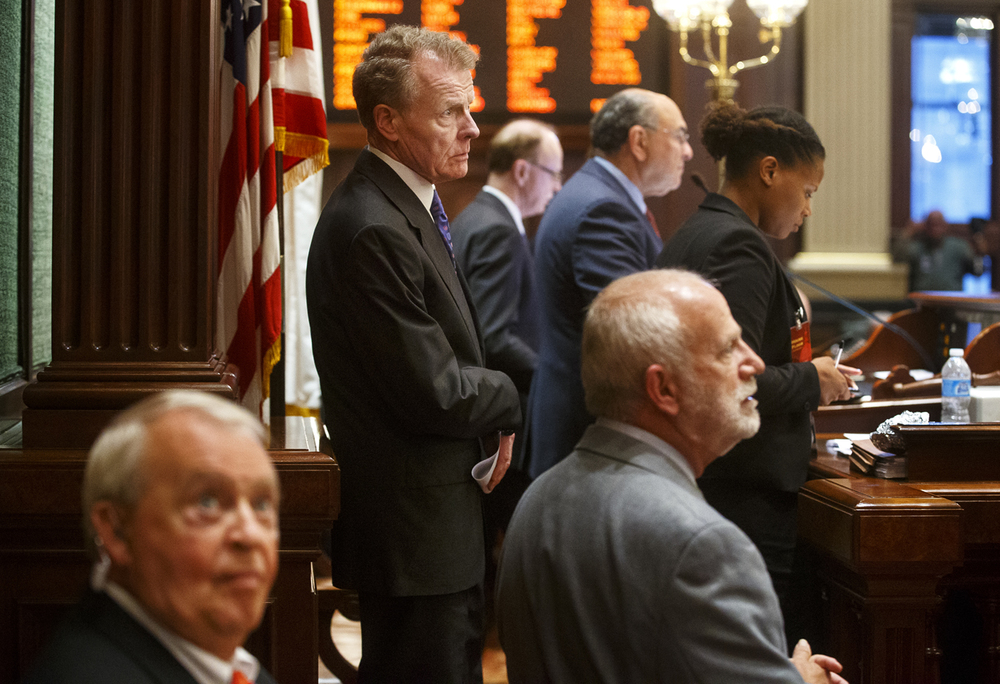 Illinois House Speaker Mike Madigan, D-Chicago, watches action on the House floor after the vote to override Gov. Bruce Rauner's veto of Senate Bill 1229 failed to pass.  Ted Schurter/The State Journal-Register