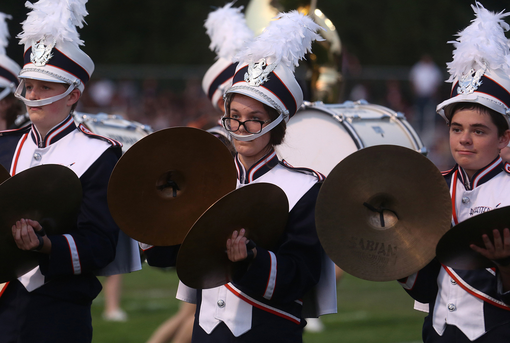 Members of the Rockets band cymbal line perform before the start of the game. The Rochester High School Rockets defeated the Springfield High School Senators 53-15 in football action at Rocket Stadium on Friday evening, Sept. 4, 2015. David Spencer/The State Journal-Register