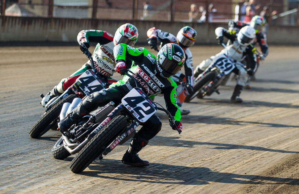 Bryan Smith slides his #42 Kawasaki to the inside to take the lead into turn one during the AMA Pro Flat Track Grand National Championship Springfield Mile II at the Illinois State Fairgrounds, Sunday, Sept. 6, 2015, in Springfield, Ill. Justin L. Fowler/The State Journal-Register