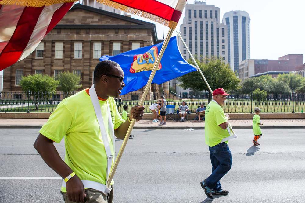 David Lacy, left, and David Greenslade, right, lead out Carpenters Local #270 during the annual Labor Day Parade, Monday, Sept. 7, 2015, in Springfield, Ill. Justin L. Fowler/The State Journal-Register