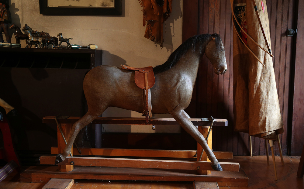 A rare rocking horse covered with horse hide is believed to date to the mid 19th Century seen in the attic playroom of the main house on Tuesday, Sept. 8, 2015. David Spencer/The State Journal-Register