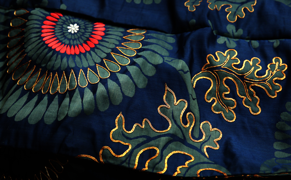 Gold thread was used in this silk kimono formerly owned and worn by Nina Gillett. (1854 - 1938) The kimono was on display on the first floor of the main house and seen on Tuesday, Sept. 8, 2015. This will be one of the few articles auctioned in September-most of the clothing will be auctioned next year. David Spencer/The State Journal-Register