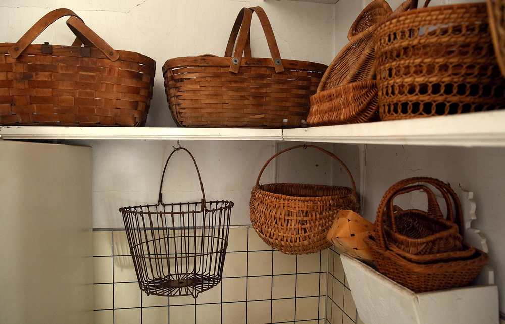 Baskets, many used to carry eggs, are seen in the Milk Room located off the main kitchen on Tuesday, Sept. 8, 2015 and will be auctioned this month.  David Spencer/The State Journal-Register
