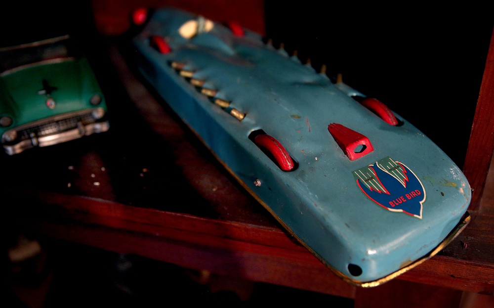 A Buffalo Toys Blue Bird Land Speed Racer from the 1930's made of tin is seen in the attic playroom on Tuesday, Sept. 8, 2015 and will be auctioned this month.  David Spencer/The State Journal-Register