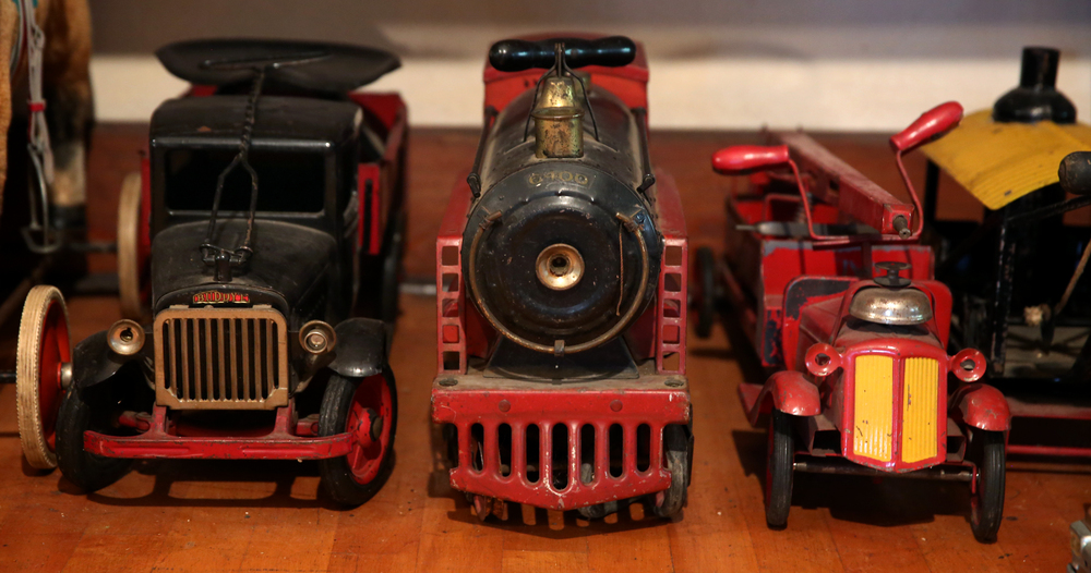 Large toys, including a Buddy L truck at left are lined up and seen in the attic playroom on Tuesday, Sept. 8, 2015 and will be auctioned this month. David Spencer/The State Journal-Register