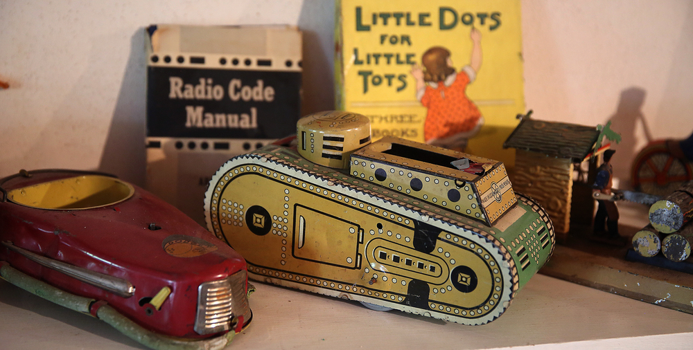 Tin toys, including a tank at center seen in the attic playroom on Tuesday, Sept. 8, 2015 will be auctioned this month.  David Spencer/The State Journal-Register