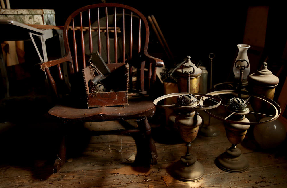 Brass kerosene lanterns are seen in the attic on Tuesday, Sept. 8, 2015 and will be auctioned this month.  David Spencer/The State Journal-Register
