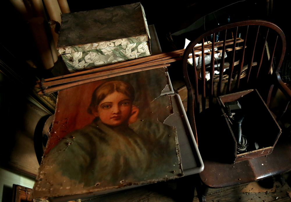 An oil painting along with other items to be auctioned seen in the attic on Tuesday, Sept. 8, 2015. David Spencer/The State Journal-Register