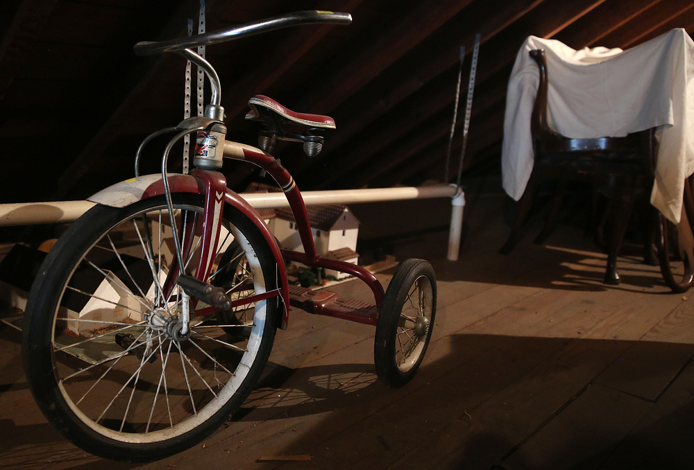 A Western Flyer tricycle from the 1950's seen in the attic on Tuesday, Sept. 8, 2015.  David Spencer/The State Journal-Register