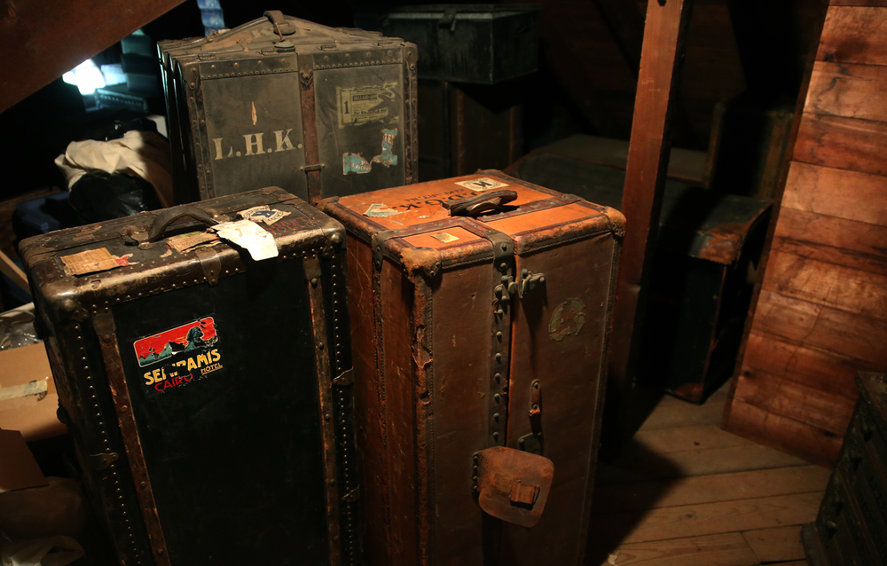 Old steamer trunks are seen in the attic on Tuesday, Sept. 8, 2015 and will be auctioned this month. David Spencer/The State Journal-Register