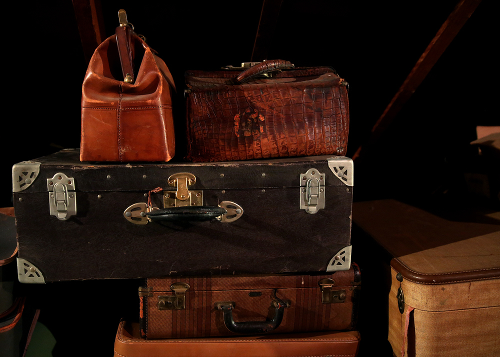 Old luggage seen in the attic on Tuesday, Sept. 8, 2015 will be auctioned this month. David Spencer/The State Journal-Register