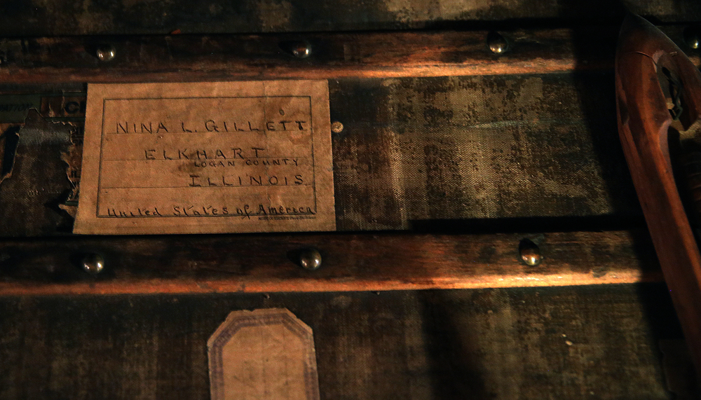 A shipping label for Nina Gillett (1854-1938) is seen on one of her old steamer trunks in the atttic on Tuesday, Sept. 8, 2015 and will be auctioned this month. David Spencer/The State Journal-Register
