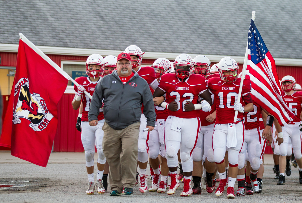 Jacksonville head football coach Mark Grounds leads his team out to the field to take on Sacred Heart-Griffin at Kraushaar-Rosenberger Field, Friday, Sept. 11, 2015, in Jacksonville, Ill. Justin L. Fowler/The State Journal-Register