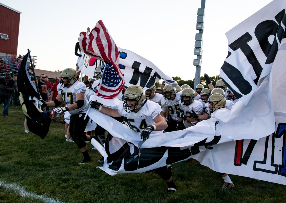 Sacred Heart-Griffin's Doug Maroon (54) leads the team out on to the field to take on Jacksonville during the first half at Kraushaar-Rosenberger Field, Friday, Sept. 11, 2015, in Jacksonville, Ill. Justin L. Fowler/The State Journal-Register