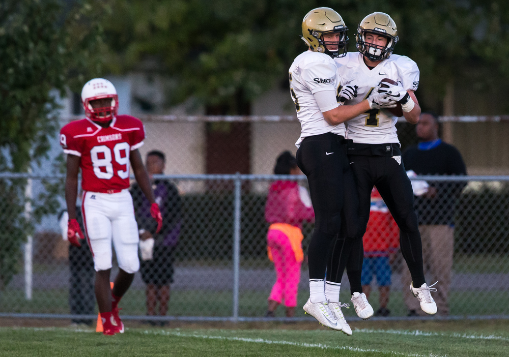 Sacred Heart-Griffin's Sam Bonansinga (4) celebrates his 59-yard touchdown reception with Jack Sigourney (95) against Jacksonville during the first half at Kraushaar-Rosenberger Field, Friday, Sept. 11, 2015, in Jacksonville, Ill. Justin L. Fowler/The State Journal-Register