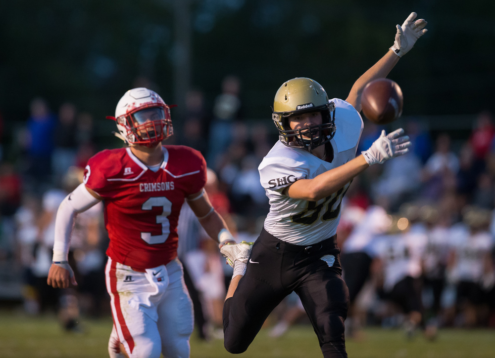 A pass sails past Sacred Heart-Griffin's Nolan Reavy (80) near the end zone with Jacksonville's Klay Wood (3) on the coverage during the first half at Kraushaar-Rosenberger Field, Friday, Sept. 11, 2015, in Jacksonville, Ill. Justin L. Fowler/The State Journal-Register