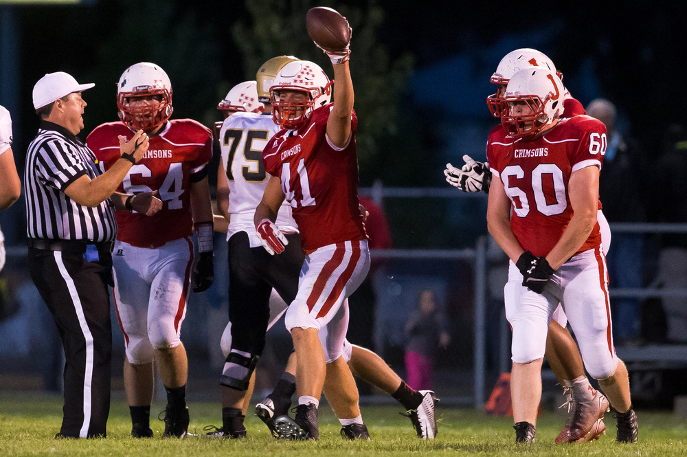 Jacksonville's Adam Hillis (41) celebrates after recovering a fumble against SHG during the first half at Kraushaar-Rosenberger Field, Friday, Sept. 11, 2015, in Jacksonville, Ill. Justin L. Fowler/The State Journal-Register