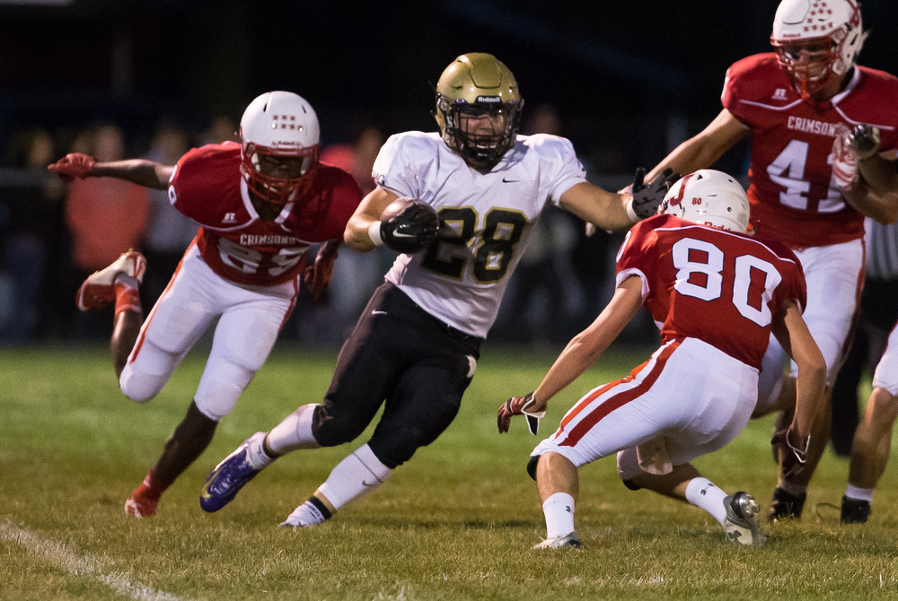 Sacred Heart-Griffin's Sam Sergent (28) cuts back on Jacksonville's Donovan Greene (80) on a rush during the first half at Kraushaar-Rosenberger Field, Friday, Sept. 11, 2015, in Jacksonville, Ill. Justin L. Fowler/The State Journal-Register