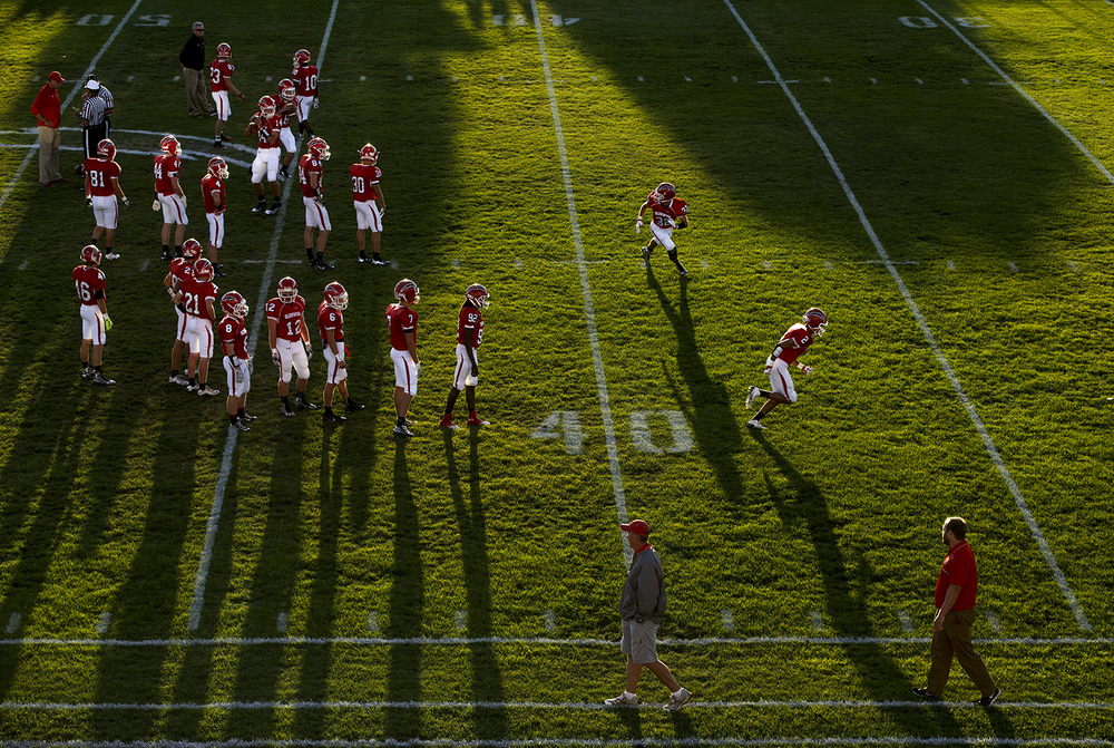 The Chatham Glenwood Titans warm up as they prepare to face Southeast at Glenwood High School Friday, Sept. 11, 2015. Ted Schurter/The State Journal-Register