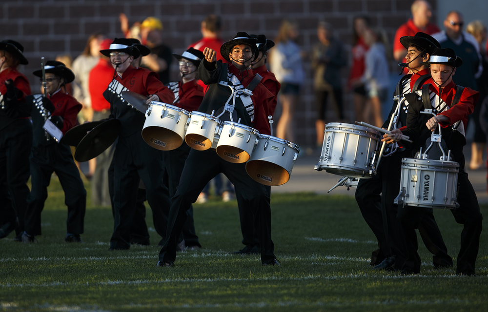 The Glenwood High School marching band dances on the field as they wait for the Titans to take the field against Southeast at Glenwood High School Friday, Sept. 11, 2015. Ted Schurter/The State Journal-Register
