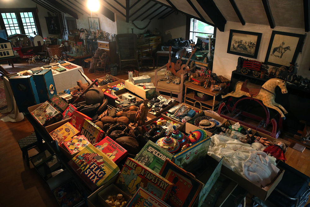 An overall view shows part of the large attic playroom with hundreds of vintage toys dating from the mid 19th Century all the way to the 1960's in the main house on Tuesday, Sept. 8, 2015. On the weekend of September 18-20th 2015, a rare estate auction will be held on the grounds of the historic Old Gillett Farm in Elkhart, IL. Established in 1868 on the highest point between Chicago and St. Louis, the property has remained in the same family for eight generations. Original contents from the Main House, barns and outbuildings will be offered in this first of a series of sales. The remarkable fact that nothing has ever left and that most pieces have a story attached to them, make these offerings exceptional. David Spencer/The State Journal-Register