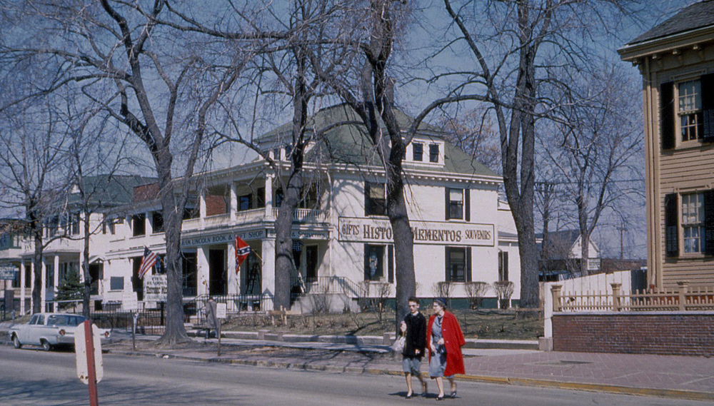1962 (ca.): Pedestrians make their way across Eighth Street in front of the Lincoln Home at right. In background is the now-demolished Abraham Lincoln Book & Gift Shop which had the street address of 416 S. 8th St. Courtesy Lincoln Home National Historic Site