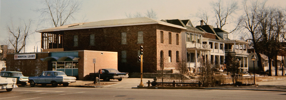1967: At the north entrance to the present Lincoln Home National Historic Site off Capitol Ave at Eighth Street, the former Beneficial Finance Company can be seen-now an empty lot-at 802 E.Capitol. Construction of the brick building seen next to the Beneficial building had begun late in 1966, and would eventually become a museum reproduction of the Elizabeth Todd and Ninian Wirt Edwards home in Springfield, where Abraham Lincoln and Mary Todd married in the dining room on Nov. 4, 1842. Courtesy Sangamon Valley Collection at Lincoln Library