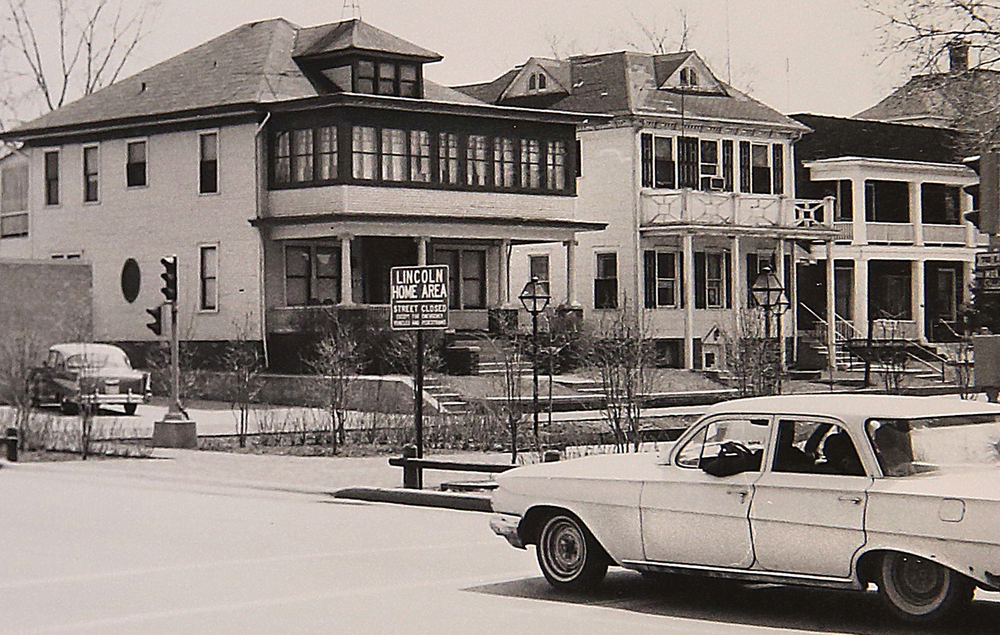 1966: An automobile travels past the north entrance to the present Lincoln Home National Historic Site off Capitol Avenue at Eighth Street. The Kent House, left, would be torn down later this year and replaced with a reproduction of the Ninian Edwards Home where Lincoln and Mary Todd married. Courtesy Sangamon Valley Collection at Lincoln Library