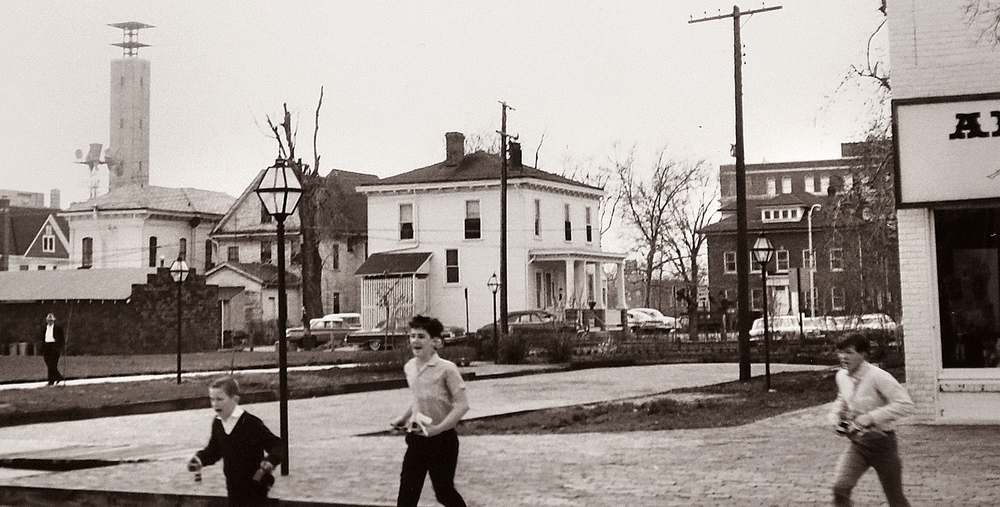 1966: Children run across Eighth Street towards the Lincoln Home. Courtesy Sangamon Valley Collection at Lincoln Library