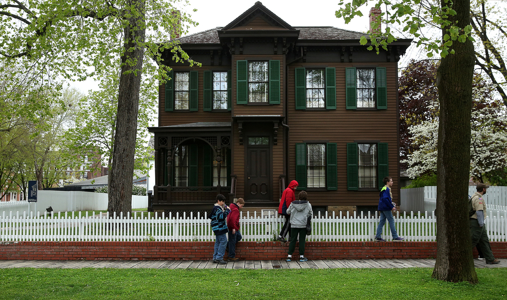 """2015: The Dean House is used as an interpretive exhibition space for the Lincoln Home National Historic Site. A description by the National Park Service says, """"The Dean House is situated on the north section of Lot 11 and the south section of Lot 12, Block 7, of the Elijah Iles Addition to Springfield. Developer Iles sold lots 10 and 11 to Dr. Gershom Jayne in May of 1837 for the sum of $750. He sold that lot to the Reverend Charles Dresser in April of 1839. Reverend Dresser, in turn, sold the lot, along with the modest house he would build on it, to Abraham Lincoln five years later."""""""