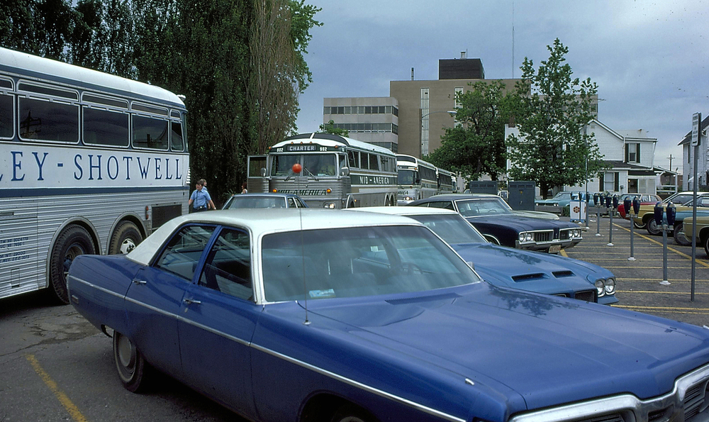 1975. Tour buses line up in the visitors parking lot behind the Lincoln Home.Courtesy Lincoln Home National Historic Site online archive