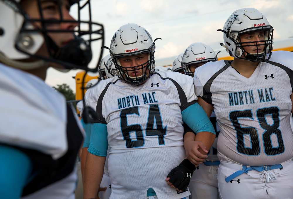 North Mac's Jon Myers (64) and Gabe Fox (68) prepare to take the field against Auburn at Michael J. Potts Memorial Field, Friday, Sept. 18, 2015, in Auburn, Ill. Justin L. Fowler/The State Journal-Register