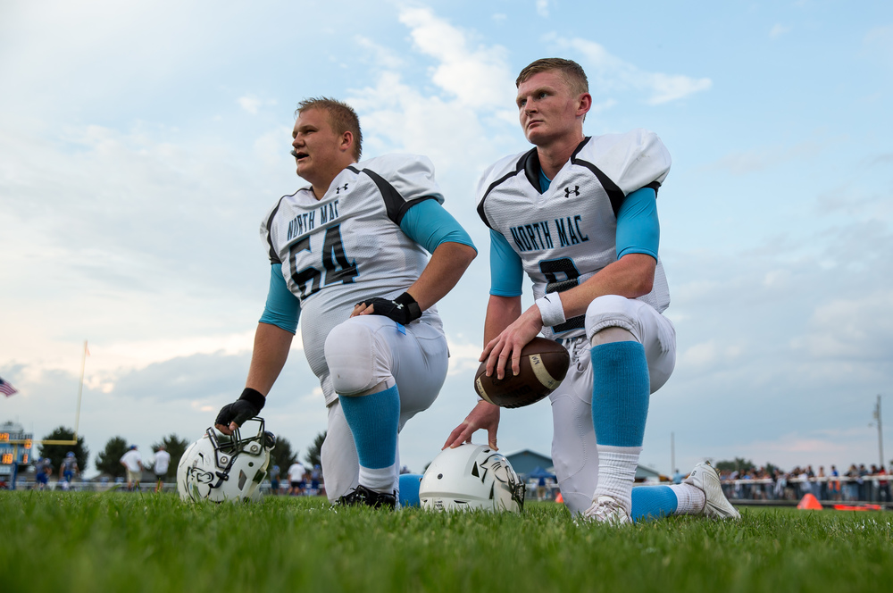 North Mac's Brennan White (9) and Jon Myers (64) take a knee during warmups prior to taking on Auburn at Michael J. Potts Memorial Field, Friday, Sept. 18, 2015, in Auburn, Ill. Justin L. Fowler/The State Journal-Register