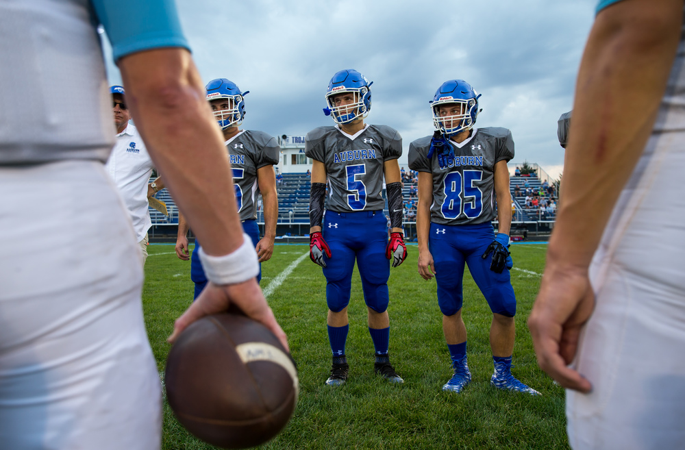 Auburn's Drew Points (5) and Nick Geoghegan (85) watch the coin toss against North Mac prior to kick off at Michael J. Potts Memorial Field, Friday, Sept. 18, 2015, in Auburn, Ill. Justin L. Fowler/The State Journal-Register