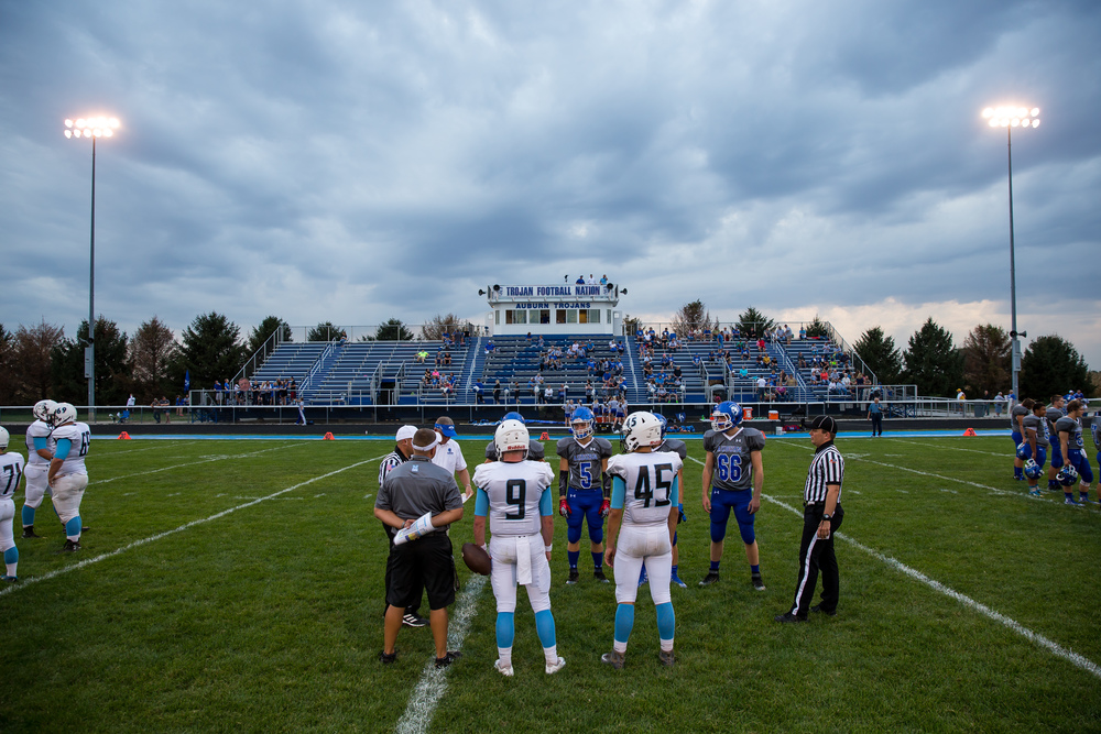 Menacing clouds begin to come over Michael J. Potts Memorial Field as Auburn and North Mac do the coin toss prior to kickoff, Friday, Sept. 18, 2015, in Auburn, Ill. Justin L. Fowler/The State Journal-Register