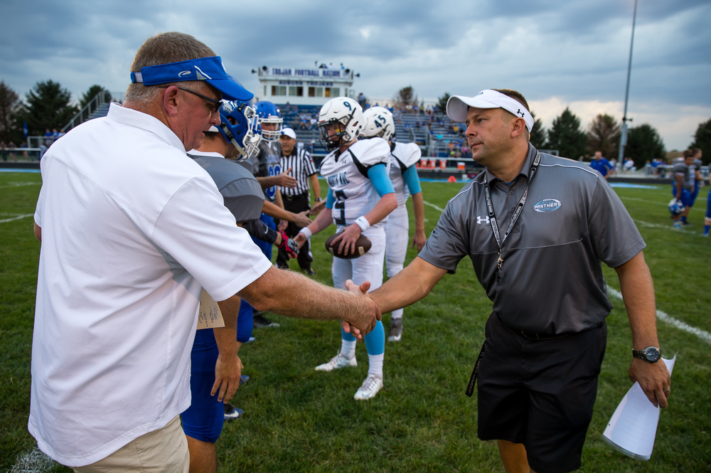 North Mac head football coach Shane Owsley, right, shakes hands with Auburn head football coach Dave Bates after the coin toss at Michael J. Potts Memorial Field, Friday, Sept. 18, 2015, in Auburn, Ill. Justin L. Fowler/The State Journal-Register