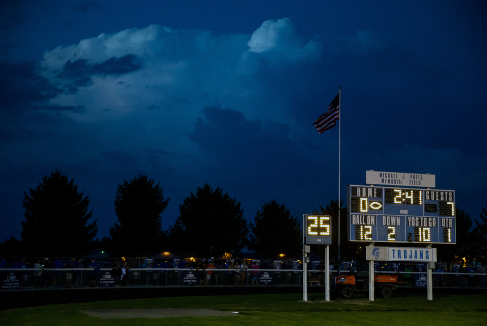 Storm clouds with lighting to the north of the field trigger a weather delay for Auburn vs. North Mac during the first quarter at Michael J. Potts Memorial Field, Friday, Sept. 18, 2015, in Auburn, Ill. Justin L. Fowler/The State Journal-Register