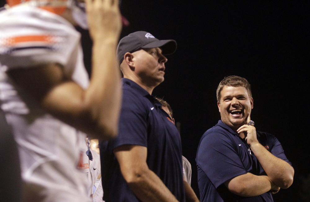 Rochester head coach Derek Leonard laughs on the sidelines as time winds down on the Rockets' 53-14 win against Glenwood at Glenwood High School Friday, Sept. 18, 2015. Ted Schurter/The State Journal-Register