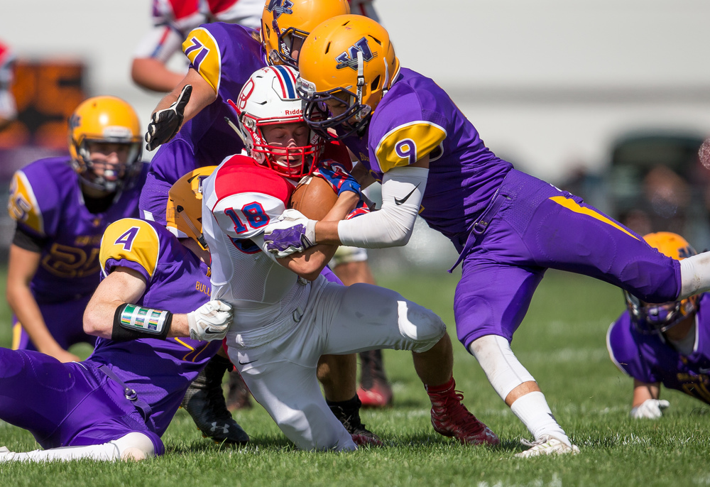 Pleasant Plains' Kevin Ingram (18) is brought down by Williamsville's Harrison Creswell (4) and Zach Dellert (9) after a catch during the second half at Paul Jenkins Field, Saturday, Sept. 19, 2015, in Williamsville, Ill. Justin L. Fowler/The State Journal-Register