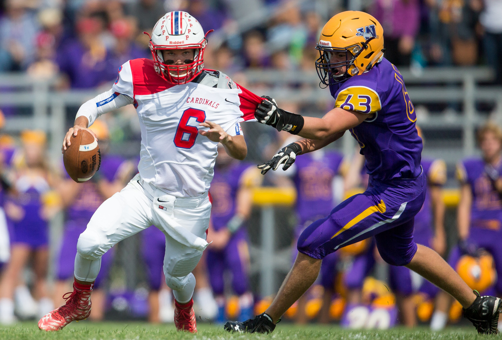Pleasant Plains' quarterback Jacob Cronister (6) tries to evade the grasp of Williamsville's Zeke Kern (63) as he scrambles out of the pocket during the second half at Paul Jenkins Field, Saturday, Sept. 19, 2015, in Williamsville, Ill. Justin L. Fowler/The State Journal-Register