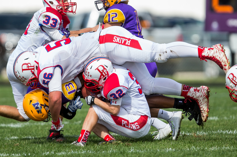 Williamsville's Jace Franklin (13) takes a hard hit from Pleasant Plains' Nik Clemens (56) on a rush during the second half at Paul Jenkins Field, Saturday, Sept. 19, 2015, in Williamsville, Ill. Justin L. Fowler/The State Journal-Register