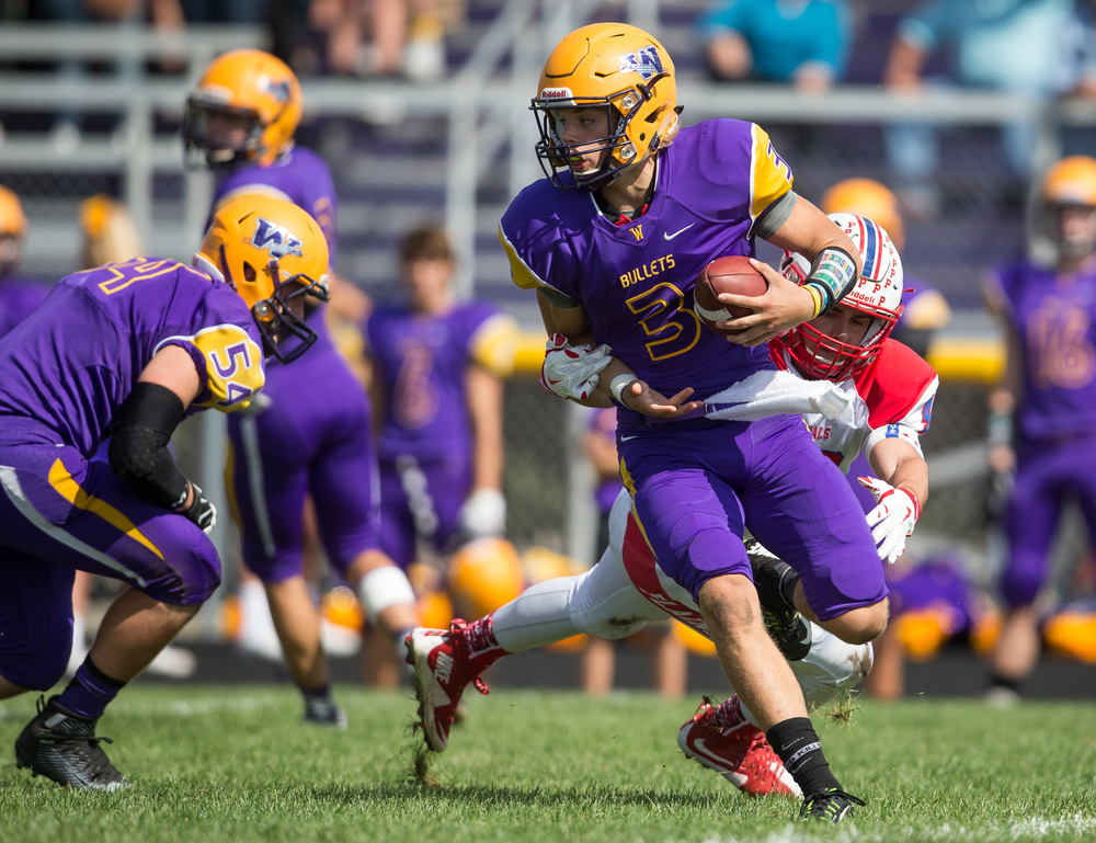 Williamsville quarterback Vince Vignali (3) avoids a sack from Pleasant Plains' Brock Hergenrother (48) during the second half at Paul Jenkins Field, Saturday, Sept. 19, 2015, in Williamsville, Ill. Justin L. Fowler/The State Journal-Register
