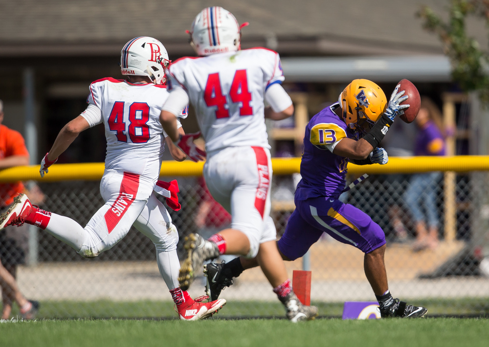 Williamsville's Jace Franklin (13) goes in for a 14-yard touchdown on fourth-down against Pleasant Plains during the second half at Paul Jenkins Field, Saturday, Sept. 19, 2015, in Williamsville, Ill. Justin L. Fowler/The State Journal-Register